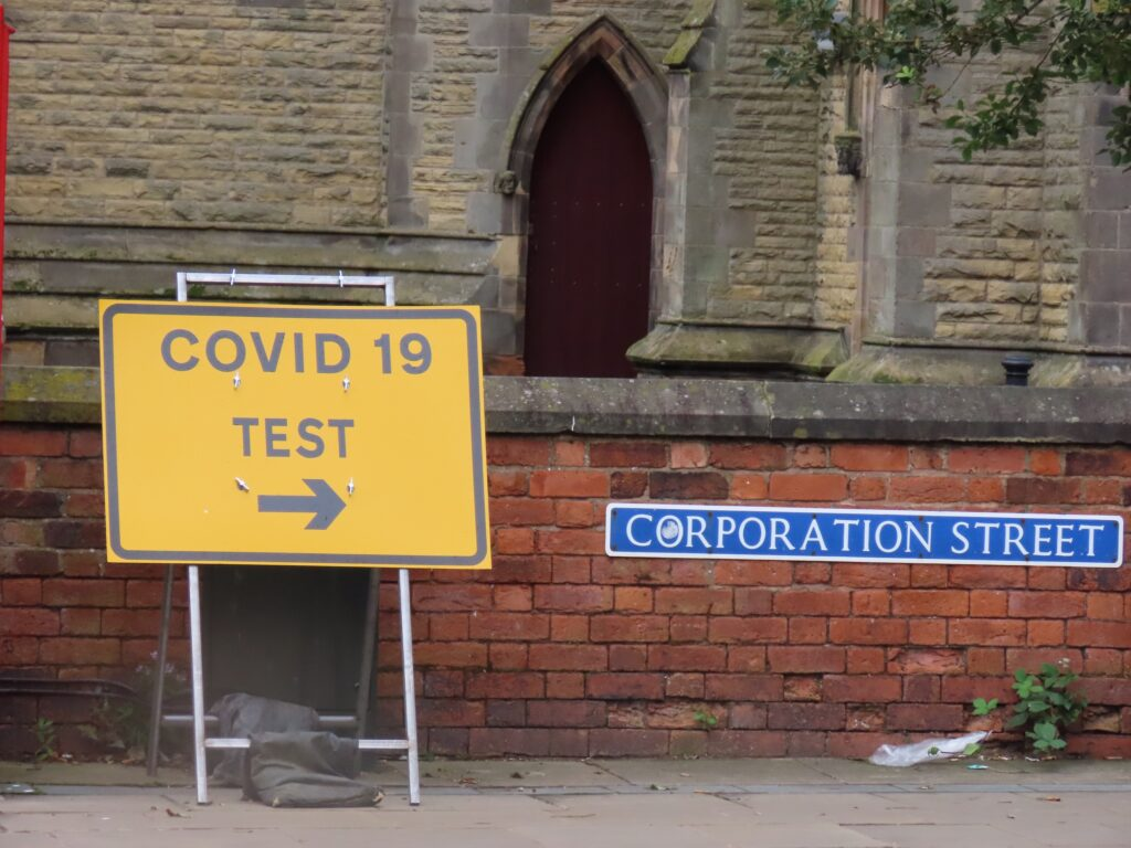 A sign posting towards the Covid-19 / coronavirus testing site on Corporation Street in Southport